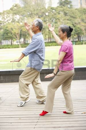 18709986-senior-chinese-couple-doing-tai-chi-in-park
